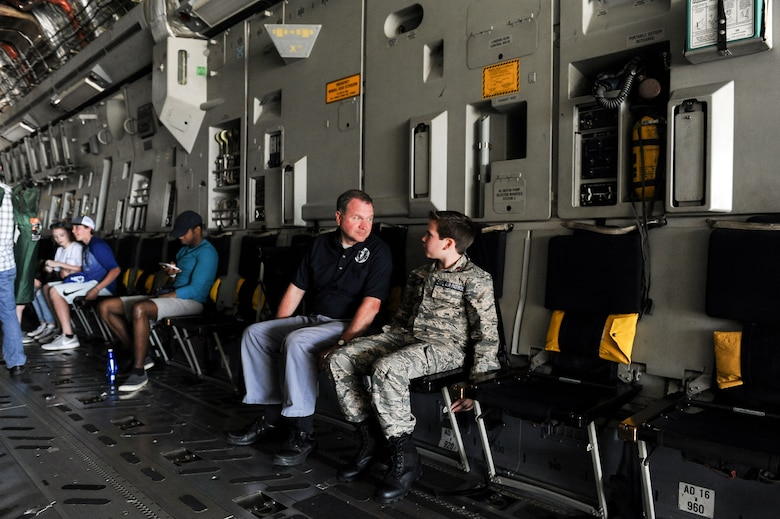Jeff Chamblee and his son, Jackson, 13, of Tupelo, Mississippi, talk to each other inside of a C-17 Globemaster III during the Wings Over Columbus Air and Space Show on Columbus Air Force Base, Mississippi. Over 15 static displays showed aircraft of all kinds during Saturday's airshow, including the C-17. (U.S. Air Force photo by Tech. Sgt. Christopher Gross)