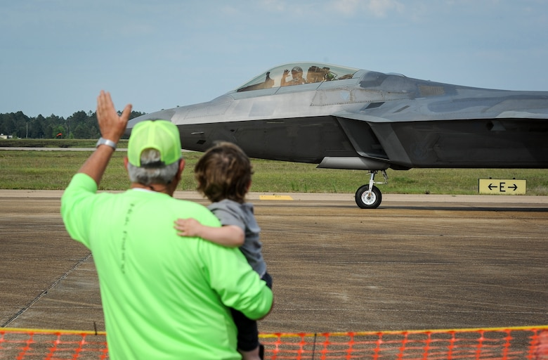 Maj. Paul Lopez, Air Combat Command F-22 Demonstration Team pilot, waves at spectators at Columbus Air Force Base, Mississippi, April 21, 2018, as he taxis out to begin his performance during the Wings Over Columbus Air and Space Show. (U.S. Air Force photo by Tech. Sgt. Christopher Gross)