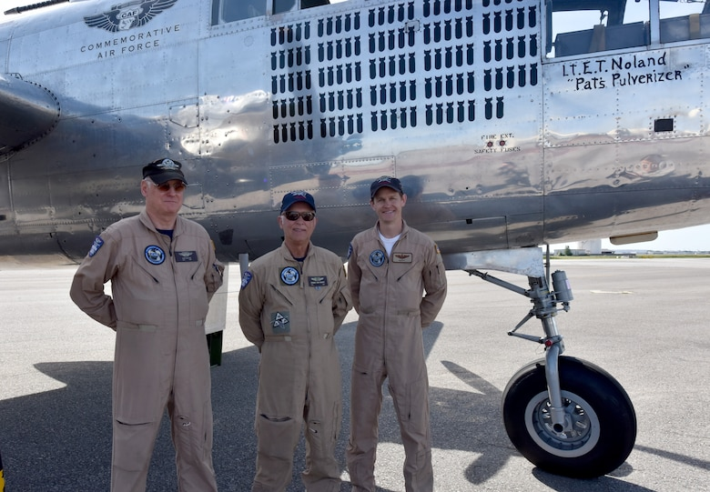 "Dean Butler, left, copilot, Roger Van Ranst, center, flight Mechanic and Matt Quiy, right, pilot stand beside the   B-25J ""Miss Mitchell,"" April, 26, 2018, on the flightline at Joint Base Charleston, S.C."