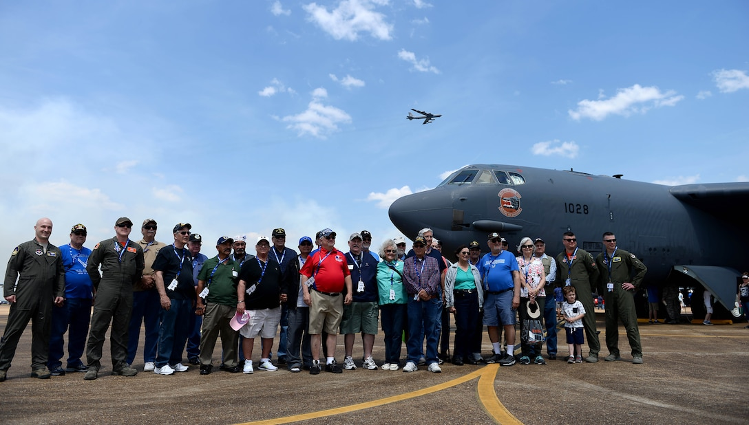 The 454th Bombardment Wing reunion group and 14th Flying Training Wing pilots, who previously have flown the B-52 Stratofortress, stand next to a B-52 static display April 21, 2018, on Columbus Air Force Base, Mississippi, during the 2018 Wings Over Columbus Open House and Air and Space Show. The 454th conducted air refueling operations and trained in bombardment operations, so a B-52 taking flight was a normal sight for many of the veterans during their time at Columbus AFB Vietnam War. (U.S. Air Force photo by Airman 1st Class Keith Holcomb)