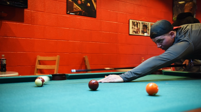 Airman Julian Groft, a 28th Communications Squadron cyber systems operations technician, plays pool as part of the Sexual Assault Awareness race at Ellsworth Air Force Base, S.D., April 20, 2018. April is Sexual Assault Awareness and Prevention Month and Ellsworth AFB is incorporating SAAPM in to Wingman Day to help spread awareness. (U.S. Air Force photo by Airman 1st Class Thomas Karol)