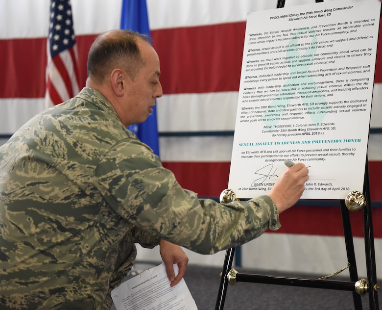 Col. John Edwards, 28th Bomb Wing commander, signs a Sexual Assault Prevention proclamation at Ellsworth Air Force Base, S.D., April 20, 2018. This sexual assault constitution shows that Ellsworth AFB recognizes sexual assault prevention efforts and aids in supporting those affected by it. (U.S. Air Force photo by Airman 1st Class Thomas Karol)