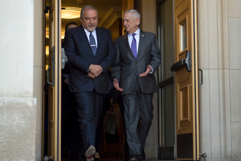 Defense Secretary James N. Mattis walks with Israeli Defense Minister Avigdor Lieberman at the Pentagon.