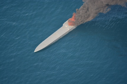A suspected smuggling vessel on fire in the Pacific Ocean.