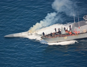 USS Zephyr conducts ship-to-ship firefighting to extinguish a fire aboard a low-profile go-fast drug vessel.