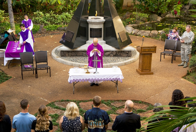 Navy Capt. John Shimotsu, U.S. Pacific Command Catholic chaplain, celebrates Mass at the Courtyard of Heroes during a remembrance ceremony at Joint Base Pearl Harbor-Hickam, Hawaii.