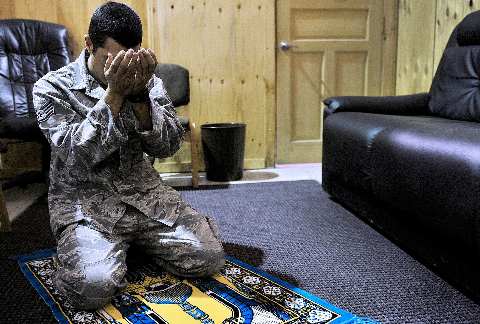 Air Force Staff Sgt. Edger Gaitan, Passenger Service NCOIC, 376th Expeditionary Logistics Readiness Squadron, prays in the distinguished visitor suite during his shift at the Passenger Terminal, Transit Center at Manas, Kyrgyzstan.