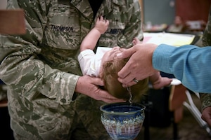Chaplain (Lt. Col.) Pat Thompson, 403rd Wing, baptizes Caleb Benkoski, son of Capt. Brenda Gohr, 403rd Wing assistant staff judge advocate, and Maj. Aric Benkoski, 132nd Wing, Iowa Air National Guard, Sept. 10, 2017 at Keesler Air Force Base, Mississippi.