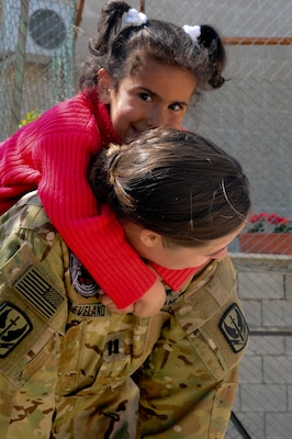 A U.S. Soldier gives a resident of the Amman SOS Children's Village a piggyback April, 23. The Soldier was part of a donation visit to the village that was arranged by Jordan Armed Forces Imams in coordination with U.S. Chaplains as part of ongoing coordination between the two partner nation militaries. Events like these help to build trust between service members and citizens of different nations.