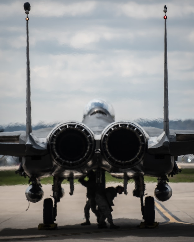 "Crew chiefs from Seymour Johnson Air Force Base, N.C., prepare one of the unit's F-15E ""Strike Eagles"" to shut down after the aircraft arrives at the Kentucky Air National Guard Base in Louisville, Ky., April 19, 2018, in preparation for the Thunder Over Louisville air show. The Kentucky Air Guard is once again serving as the base of operations for dozens of military aircraft participating in the show, providing essential maintenance and logistical support. (U.S. Air National Guard photo by Lt. Col. Dale Greer)"