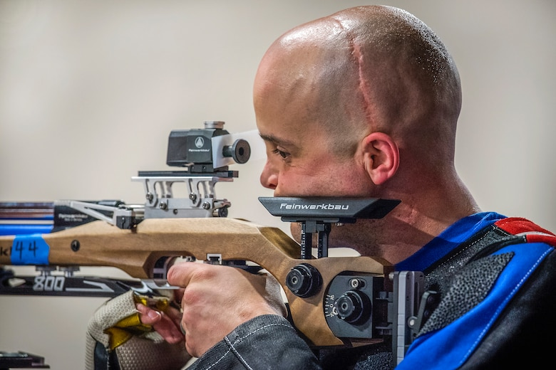 John Meyer, Warrior Games athlete, takes aim downrange at a shooting session of the adaptive sports camp at Eglin Air Force Base, Fla., April 16, 2018. The base-hosted, week-long Warrior Games training camp is the last team practice session before the yearly competition in June. (U.S. Air Force photo by Samuel King Jr.)