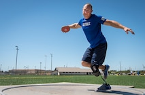 Ben Seekell, Warrior Games athlete, goes into his discus rotation during a track and field session at the Air Force team's training camp at Eglin Air Force Base, Fla., April 16, 2018. The base-hosted, week-long Warrior Games training camp is the last team practice session before the yearly competition in June. (U.S. Air Force photo by Samuel King Jr.)