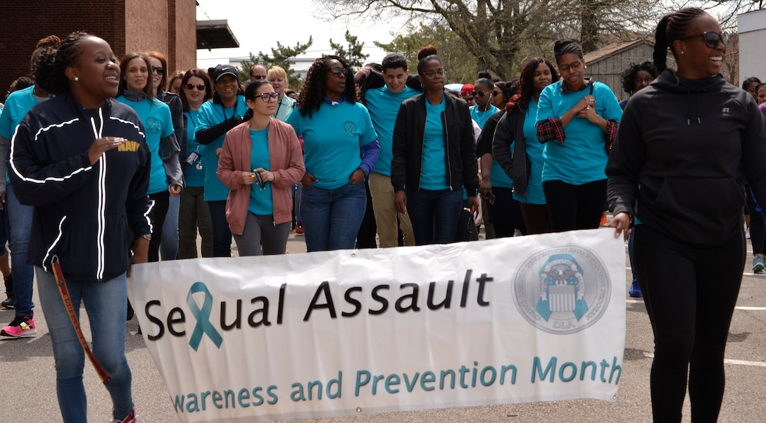 "NSA Philadelphia tenant agencies come together for the ""Walk a Mile in their Shoes"" Sexual Assault Awareness and Prevention Month event on April 24."