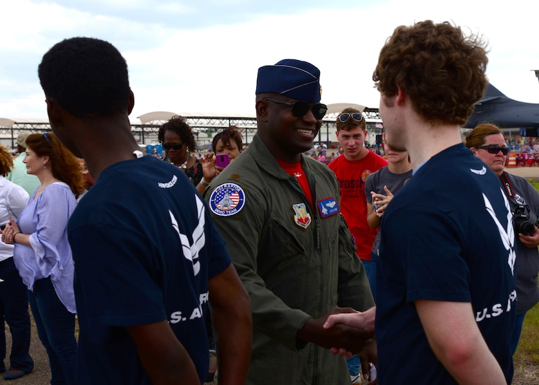 Maj. Paul Lopez, Air Combat Command's F-22 Demonstration Team pilot, greets Air Force recruits during the 2018 Wings Over Columbus Air and Space Show April 21, 2018, on Columbus Air Force, Base, Mississippi. Lopez administered the recruits' oath of enlistment during the air show. (U.S. Air Force photo by Airman 1st Class Beaux Hebert)