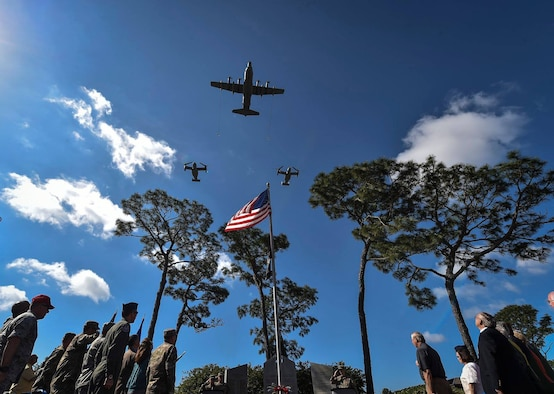 An MC-130H Combat Talon II with the 15th Special Operations Squadron and two CV-22 Ospreys with the 8th Special Operations Squadron, perform a flyover during a remembrance ceremony on the 38th anniversary of Operation Eagle Claw, April 24, 2018, at Hurlburt Field, Fla. Operation Eagle Claw was an attempted hostage-rescue mission in 1980 that resulted in five Airmen and three Marines sacrificing their lives when two of the aircraft involved collided at Desert One, the staging site for the mission. (U.S. Air Force photo by Staff Sgt. Ryan Conroy)