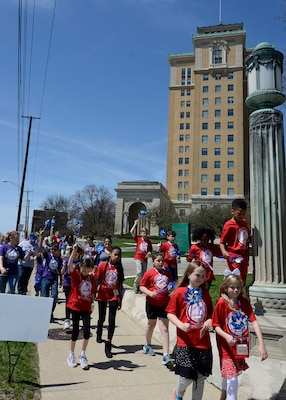 Children lead the way on the Walk for Child Abuse Awareness around the Hart-Dole-Inouye Federal Center.