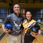 U.S. Air Force Staff Sgt. James McTaggart, assigned to the  Creech Air Force Base, Nev., (left), and U.S. Army Staff Sgt. Rose Aguilar, assigned to Fort Bliss, Texas, right, pose for a photo during the 2018 Armed Forces Bowling Championship at Ten Strike Bowling Center. Mc Taggart and Aguilar were the male and female first place winners of the competition. (U.S. Navy photo by Mass Communication Specialist Seaman Michael DiGabriele/Released)