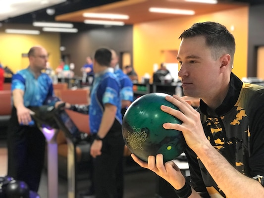Staff Sgt. Chris Artebum of Joint Base Lewis-McChord, Wash. wins bronze in the 2018 Armed Forces Bowling Championship at Ten Strike Bowling Center at Fort Lee, Va. from 13-17 April. The annual tournament features doubles, mixed doubles, individuals and team challenges. (U.S. Navy Photo by Mass Communications Specialist 2nd Class Orlando Quintero/Released)