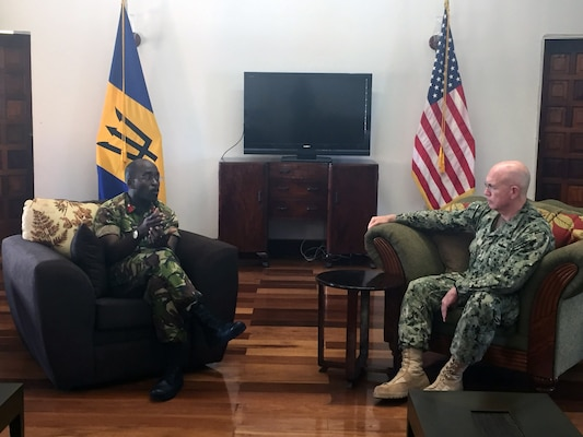 Adm. Kurt W. Tidd talks with Chief of Staff Barbados Defence Force Col. Glyne Grannum.