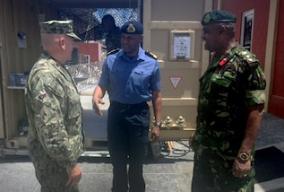 Navy Adm. Kurt W. Tidd talks with members of the Trinidad and Tobago Defence Force and Police Service.