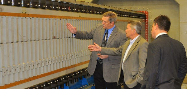 IMAGE: DAHLGREN, Va. (April 24, 2018) - U.S. Rep. Jody Hice, (R-Ga.), center, discusses the laboratory railgun's construction with Chester Petry, electromagnetic railgun lead systems engineer at Naval Surface Warfare Center Dahlgren Division (NSWCDD). Petry described its construction after the congressman witnessed the railgun launcher fire an experimental round at the NSWCDD Potomac River Test Range. Throughout his tour of NSWCDD facilities, Hice - a House Armed Services Committee member - saw the command's capability to develop and integrate complex warfare systems, including the ability to incorporate electric weapons technology into existing and future fighting forces and platforms. Looking on is Dale Sisson, NSWCDD deputy technical director.  (U.S. Navy photo by John Joyce/Released)