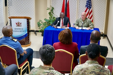 Adm. Kurt W. Tidd and Minister of National Security Edmund Dillon conduct a news conference
