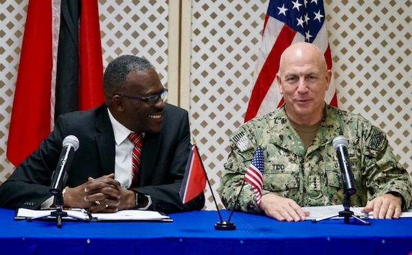 Adm. Kurt W. Tidd and Minister of National Security Edmund Dillon conduct a news conference.