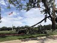 Damaged trees litter the Offutt Air Force Base parade grounds after a tornado swept through Offutt Air Force Base, Nebraska, June 16, 2017. Learning how to prepare for and respond to severe weather may reduce stress and increase the odds of making it through a disaster unscathed. (U.S. Air Force photo by Ryan Hansen)