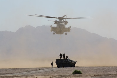 A U.S. Marine Corps Sikorsky CH-53 Sea Stallion makes its approach during an external lift exercise in conjunction with Weapons and Tactics Instructor Course 2-18 in Yuma, Ariz., April 4, 2018.