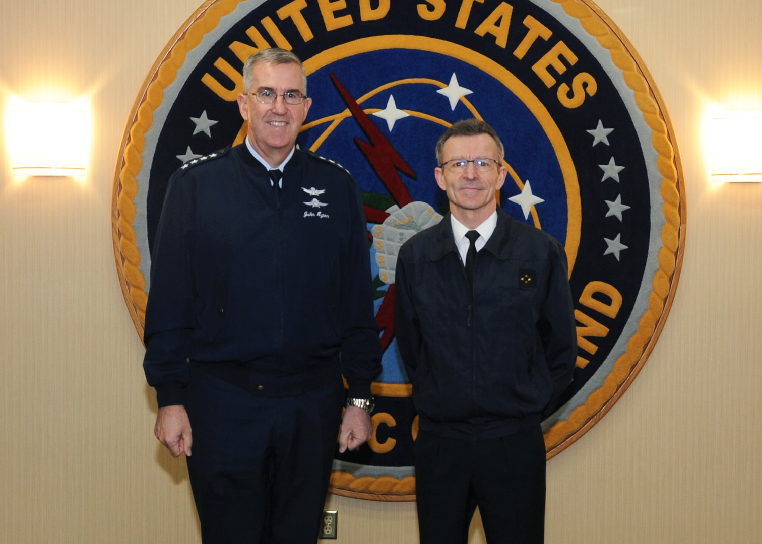 U.S. Air Force Gen. John Hyten, commander of U.S. Strategic Command (USSTRATCOM), welcomes French Air Force Lt. Gen. Bernard Schuler, commander of French Strategic Air Command, to USSTRATCOM headquarters at Offutt Air Force Base, Neb., April 23, 2018. During his visit, Schuler toured the command's Global Operations Center and participated in discussions with Hyten, other senior leaders and subject matter experts on the continuing cooperation between the U.S. and France.