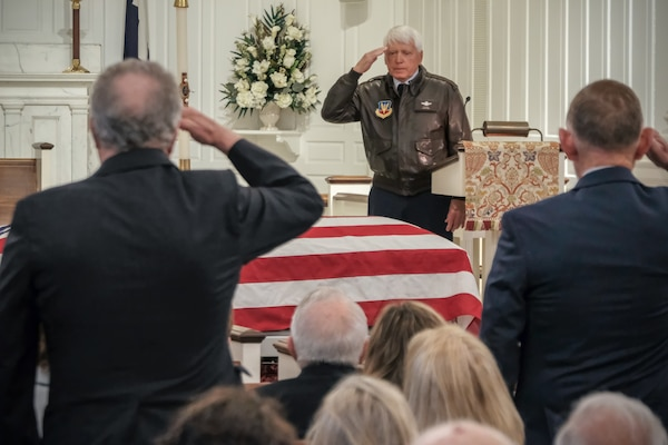 "USAF Col. (retired) Edward Sykes leads a ""brothers salute"" during a funeral service held for Air Force Reserve 1st Lt. David T. Dinan, III, on April 25, 2018 at Arlington National Cemetery. Lt. Dinan was shot down and lost in Laos in 1969. DPAA accounted for Lt. Dinan on Aug. 7, 2017 after conducting several investigation missions that led to the recovery of his remains. (DPAA photo by Mr. Lee O. Tucker)"