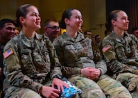 U.S. Army Soldiers laugh during a presentation in Fort Eustis' Jacobs Conference Center at Joint Base Langley-Eustis, Virginia, April 25, 2018. Soldiers attended an unconventional Sexual Harassment/Assault Response and Prevention Program training that used humor to connect with Soldiers. (U.S. Air Force photo by Airman 1st Class Monica Roybal)