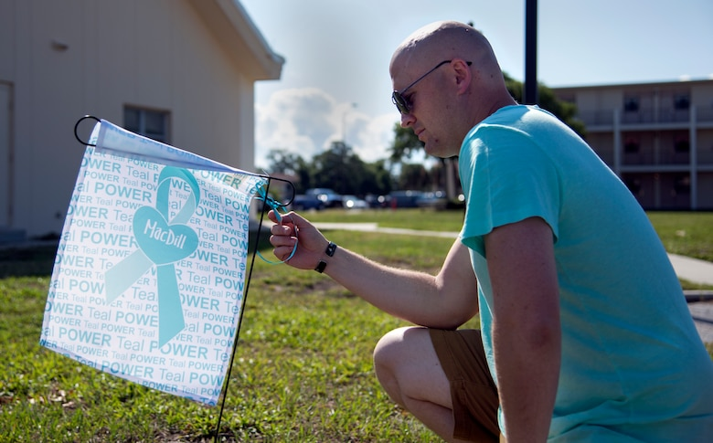 U.S. Air Force Staff Sgt. Shane Hilts, a contract specialist assigned to the 6th Contracting Squadron, reads a clue attached to a Sexual Assault Prevention and Response (SAPR) flag outside the base chapel at MacDill Air Force Base, Fla., April 27, 2018.