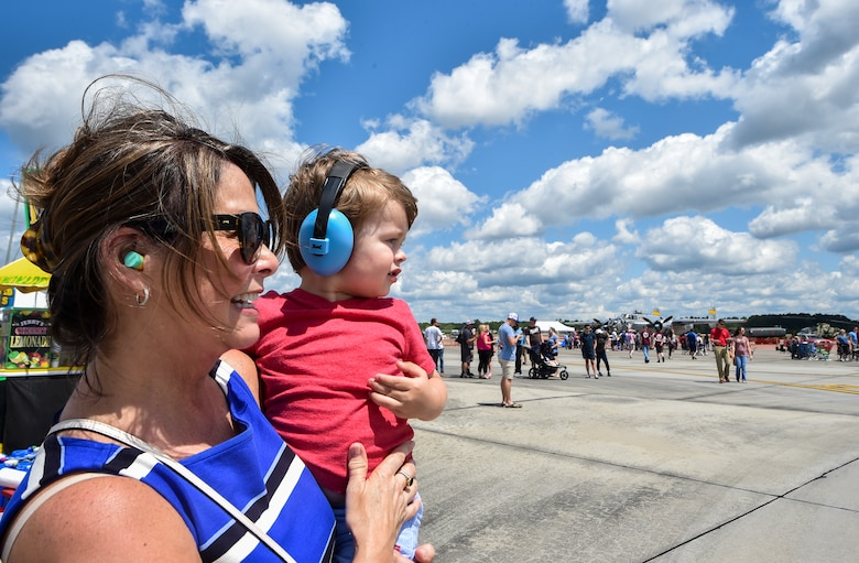 Spectators watch an aerial act at the Air & Space Expo rehearsal at Joint Base Charleston, S.C., April 27, 2018.
