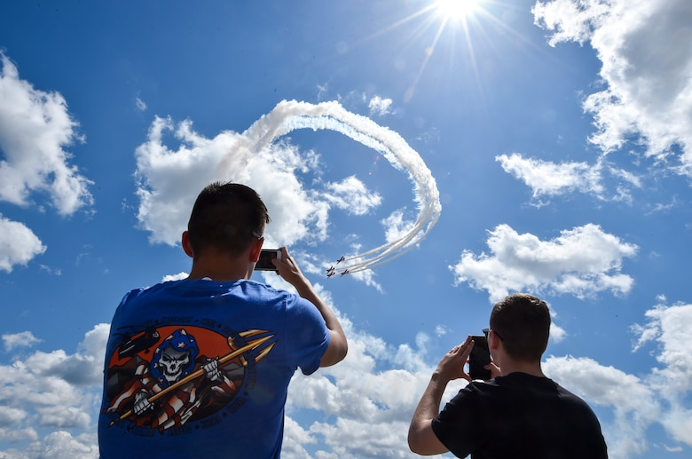 Spectators take photo of an aerial act at the Air and Space Expo rehearsal at Joint Base Charleston, S.C., April 27, 2018.