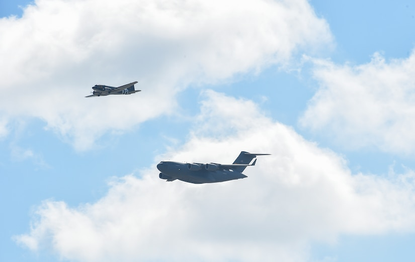 A C-47 Skytrain and a C-17 Globemaster III fly during a heritage flight at the 2018 Air and Space Expo rehearsal at Joint Base Charleston, S.C., April 27, 2018.