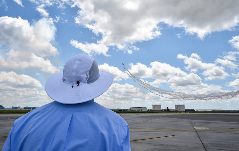 A spectator watches an aerial act during the 2018 Air and Space Expo rehearsal at Joint Base Charleston, S.C., April 27, 2018.
