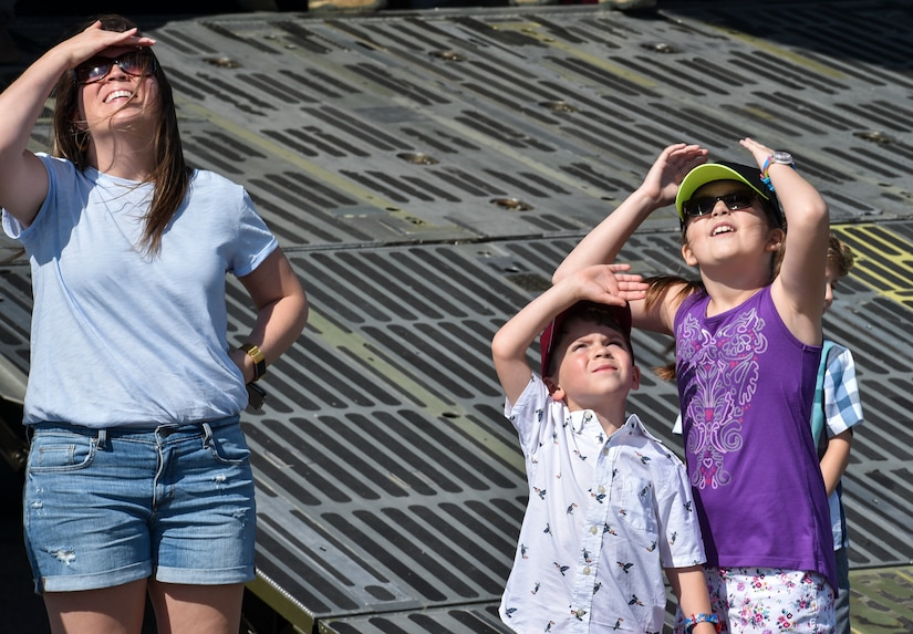 Spectators at the 2018 Air and Space Expo rehearsal watch as an aerial act flies over them at Joint Base Charleston, S.C., April 27, 2018.