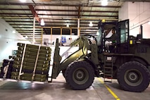U.S. Air Force Airman 1st Class Tyler Neff, a member of the 509th Logistics Readiness Squadron, transfers weapons with a 10K-AT forklift driver at Whiteman Air Force Base, Mo., Jan. 13, 2018, in support of a 442d Fighter Wing deployment. The 509th and 131st work together to ensure missions, such as deployments and humanitarian efforts, are successful. (U.S. Air Force photo by Staff Sgt. Danielle Quilla)