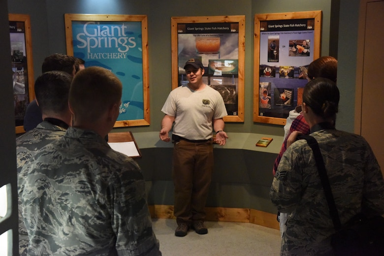 Matt Wipf, Montana Fish, Wildlife and Parks fish culture specialist, talks to the Big Sky Post Society of American Military Engineers at their monthly meeting during a tour of the Giant Spring fish hatchery April 26, 2018, at Giant Springs State Park, Mont. Many of Malmstrom's military members participate in Big Sky Post events that provide opportunities to learn about the infrastructure and operations of other organizations. (U.S. Air Force photo by Kiersten McCutchan)
