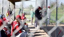 Andy Martins, a manager for the Warrensburg High School baseball team, watches the game at West Park in Warrensburg, Mo., April 16, 2018. Even though he has autism, Andy is a vital member of the team. He ensures the pitchers do not exceed the limit number of throws per game, which is put in place to prevent injury. (U.S. Air Force photo by Staff Sgt. Danielle Quilla)