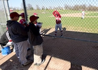 Andy Martins, a manager for the Warrensburg High School baseball team, watches the game at West Park in Warrensburg, Mo., April 16, 2018. Ever since he was 6 years old, Andy has been involved in sports, which has helped him with his autism. (U.S. Air Force photo by Staff Sgt. Danielle Quilla)