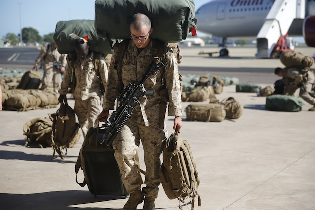 U.S. Marines and Sailors with Marine Rotational Force – Darwin 2018 collect their luggage and proceed to customs after arriving at the Royal Australian Air Force Base Darwin, Australia.