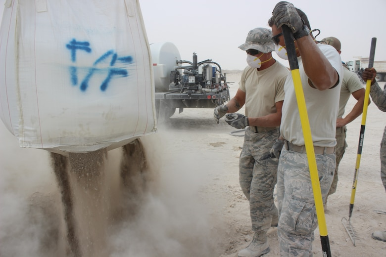 Dry concrete transported by a telehandler is placed into a crater on a mock damaged airfield at Al Udeid Air Base, Qatar on April 25, 2018. The machinery is part of an arsenal of new equipment civil engineers use for backfilling and capping craters as part of Rapid Airfield Damage Recovery (RADR). Civil engineers can now guarantee repairs to full operational capability in a matter of hours. This is also the first time RADR has been utilized in AFCENT. (U.S. Air Force photo by Tech. Sgt. Arthur Mondale Wright)