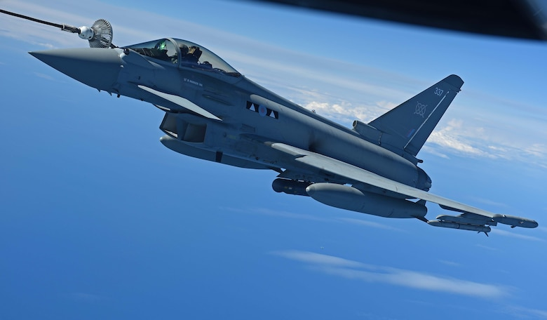 A Royal Air Force Typhoon receives fuel from a U.S. Air Force KC-135 Stratotanker during the U.K.-led Exercise Joint Warrior over England, April 25, 2018. The KC-135 offloaded more than 7,000 pounds of fuel in support of the exercise that involved U.K., NATO and allied units. (U.S. Air Force photo by Senior Airman Luke Milano)