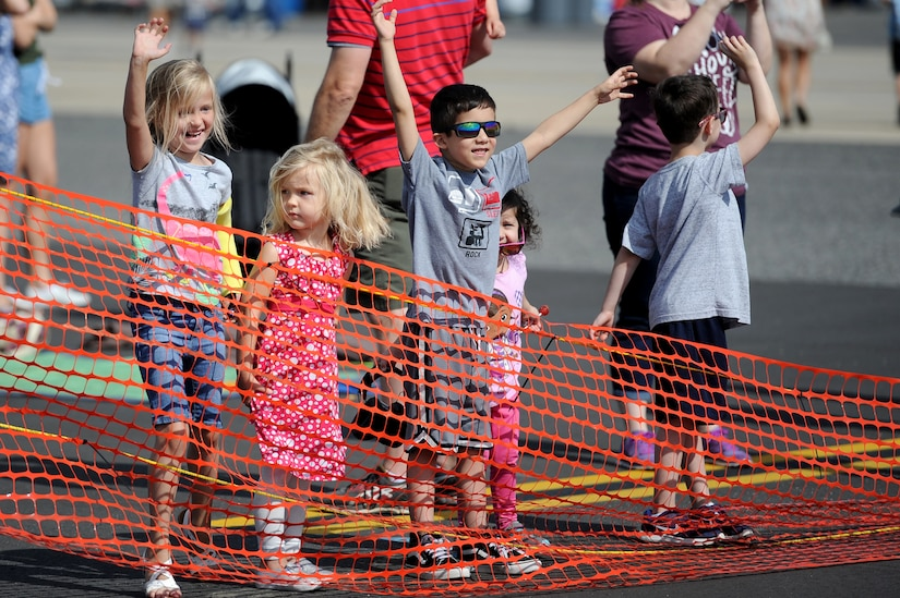 Children cheer as members of the U.S. Army Special Operations Command Daggers Parachute Demonstration Team, known as the Black Daggers, prepare to land during the Air and Space Expo rehearsal April 27, 2018, at Joint Base Charleston, S.C.