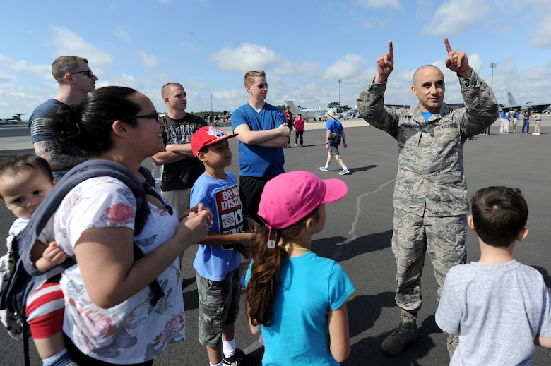 Master Sgt. Michael Howell, 437th Aerial Port Squadron, NCO in charge of the command section, tells his family and friends about his experience tandem jumping with the U.S. Army Special Operations Command Daggers Parachute Demonstration Team during the 2018 Air and Space Expo rehearsal April 27, 2018.