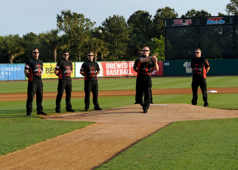 Master Sgt. Christopher Malone, U.S. Army Special Operations Command Black Daggers Parachute Demonstration Detachment demonstrator, throws a ceremonial first pitch at a Joseph P. Riley, Jr. Park during a Charleston RiverDogs baseball game, April 26, 2018.