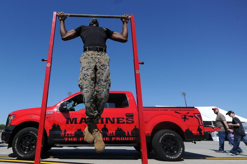 U.S. Marine Corps Sgt. Tony Pressley, Recruiter, performs pull-ups during the Air and Space Expo April 28, 2018, at Joint Base Charleston, S.C. The 2018 Air and Space offered more than 50 demonstrations and displays ranging from Science, Technology, Engineering and Mathematics activities to World War II static display aircraft and aerial demonstration performances highlighting the F-16 Fighting Falcon, C-17 Globemaster III, F-86 Sabre and more. The AeroShell Aerobatics Team headlined the event, wrapping up the full-day show.