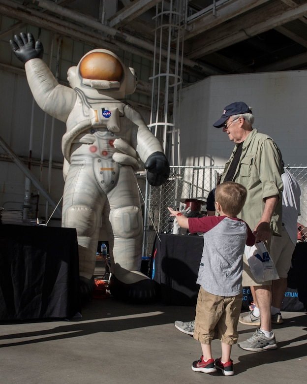 A young boy waves at an inflatible astronaut during the Joint Base Charleston Air and Space Expo at JB Charleston, S.C.  Apr 28, 2018.